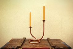 Two-candle candlestick made with copper pipes.