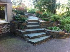Bluestone Steps Sloped Backyard Google Search Building A House Sloped Backyard Backyard Landscaping Stone Retaining Wall