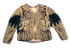 A silk velvet jacket from the La collection costumes du musee national des arts et traditions populaires alger.