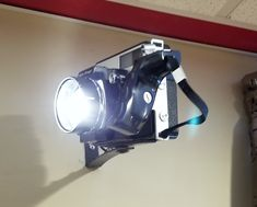 ♥♥♥This is a camera I converted to a flood light to shine on the beer bottle clock I made.♥♥♥