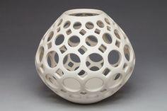 Teardrop Lantern/Vessel by Lynne Meade. Made of pierced porcelain with white satin matte glaze.