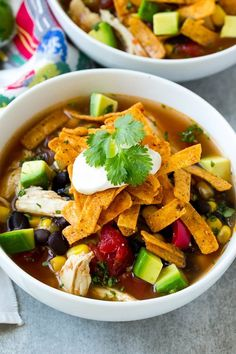 This slow cooker chicken tortilla soup recipe is filled with chicken, beans and veggies, all finished off with tortilla strips and a variety of toppings.