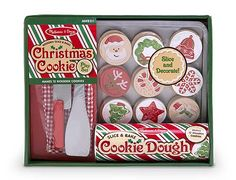 Slice & Bake Christmas Cookie Play Set : Slice and pretend to bake a dozen wooden cookies, then decorate them for Christmas! This colorful play-food set includes a tube of 12 sliceable cookies with 12 decorative toppings, an oven mitt, wooden cookie sheet, knife and spatula, plus  pretend baking directions to encourage unlimited imaginative play and learning. Its a festive way to reinforce basic skills, encourage creativity and celebrate the holidays!