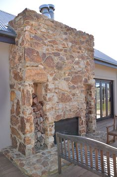 A stone outdoor fireplace we have built