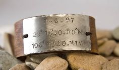 """Leather and nickel """"Where We Met"""" bracelet. $24. - way cool - I want one in """"aqua"""" with coordinates for Cancun <3  and maybe one for where I live in black :D"""