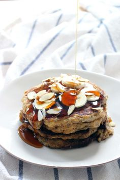 Hearty, delicious, and fluffy banana pancakes with chia seeds added, made with whole wheat flour and sweetened with honey. A healthy, energy boosting breakfast!