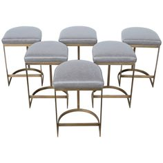 Milo Baughman Burnished Brass Bar Stools in Grey Leather | From a unique collection of antique and modern stools at https://www.1stdibs.com/furniture/seating/stools/
