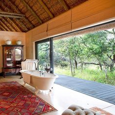 There's no finer holiday indulgence than a long bath. At Royal Malewane you can do just that - in perfect harmony with nature and the passing wildlife. And with a glass of vintage Bollinger of course. #safari #krugernationalpark #travel #instatravel #luxury #luxurytravel #beautifulhotels #bath #bathroom #beautifulbathroom #design #nature #relax #bollinger #champagne #southafrica #royalmalewane #theroyalportfolio #africa @royalmalewane by theroyalportfolio Bathroom remodeling ideas.