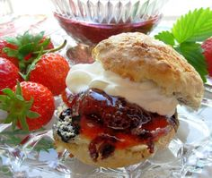 Devon Cream Tea: Home-made scones and strawberry jam topped with Devon clotted cream. ... Served with a pot of freshly brewed English tea. <3