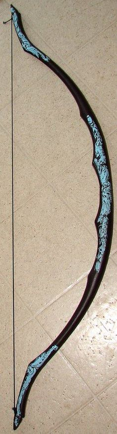 Wow, just lovely! Never seen a traditional recurve painted black. Awesome.