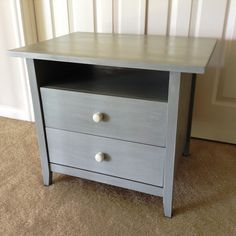 A very cute bedside table painted in chalk style paint Sage Gray and given a whitewash to add some depth of color. Knobs painted white. Mary's Garden of Refinished Treasures www.facebook.com