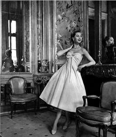 1956 Ghislaine Arsac in white ottoman strapless evening dress by Christian Dior