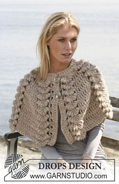 "DROPS 110-9 - Crochet DROPS cape with shell pattern in ""Eskimo"". Size S - XL."