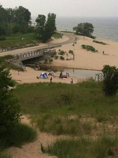 Beautiful Duck Lake Channel with dunes, beach and Lake Michigan. A favorite gathering place for families on summer days.