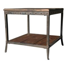 Rustic modern design enters a whole new realm with this solid pine wood and black iron table. The handcrafted frame has stud details that emphasize its sturdy construction while adding another layer of visual interest.