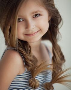 Beautiful little girl hair- Loose fishtail braid pigtails w the ends looped up.