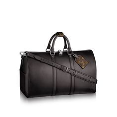 Discover Louis Vuitton Keepall Bandoulière 50  Proposed in Eclipse leather, this iconic travel model has never looked so chic. The sophisticated leather patina brings volume to the Keepall 50's lines. A must-have for serious leather connoisseurs.