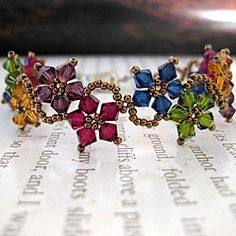 Stainless Steel Multicolor Delicate Crystal Flower Bracelet (USA) - Overstock Shopping - The Best Prices on Bracelets Bead Jewellery, Beaded Jewelry, Handmade Jewelry, Beaded Bracelets, Jewelry Findings, Silver Jewelry, Jewelry Patterns, Beading Patterns, Bead Crafts