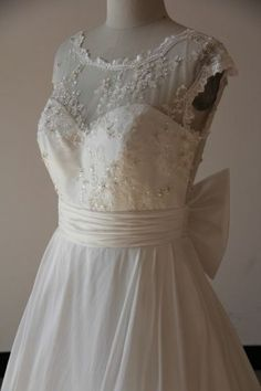 #plussizebridal - This empire waist wedding dress is a great style for a plus size bride. The Cap Sleeve Plus Size Wedding Gown has an a-line cut to the skirt. You can have this made in any size and with ANY changes. Formore info and pricing please go to https://www.dariuscordell.com/featured/plus-size-wedding-dresses-bridal-gowns/