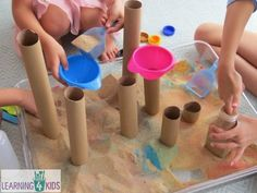 Sensory play with sand and cardboard tubes by jewell