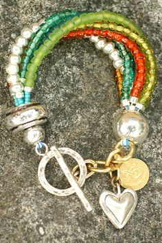Colorful Silver and Glass Heart Charm Bracelet $125