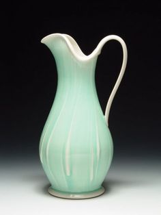 Monica Ripley, Water Pitcher. Altered and slip decorated porcelain, fired in oxidation to cone 10