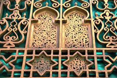 Fez - Moulay Idris Grill II by zishsheikh on Flickr.An iron grill window in the old city of Fez. There is iron calligraphy in the centre arched-shapes.