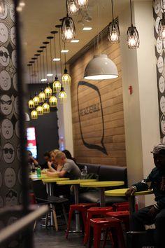 Cool cafe colour scheme | bright accents invigorate narrow space | #smallrestaurantinteriors #commercialinteriordesign #brightcoloraccents