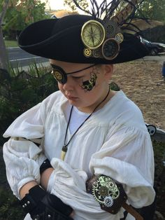DIY Kids Steampunk Pirate Costume DIY Kids Steampunk Pirate Costume: added gears, charms, homemade nautical compass & steam gauge to a eyepatch and black felt tricorn hat for a Steampunk twist in a traditional pirate costume. Diy Pirate Costume For Kids, Diesel, Fold Over Boots, Steampunk Pirate, Pirate Fashion, Nautical Compass, Boot Toppers, Pirate Hats, Diy Hat