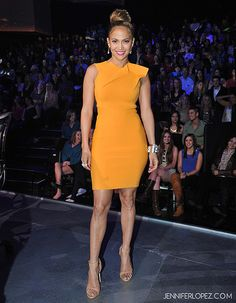 Roland Mouret Marigold dress. I can't really stand J Lo but this color is amazing. Love the nude shoe with it