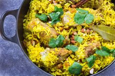 Weeknight Chicken Biryani! This stovetop version of the well-known Indian rice dish is made with chicken and seasoned with turmeric and ginger. Ready for the table in under an hour.