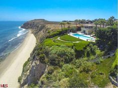 This exceptional European style villa located on over an acre on Point Dume bluff with beautiful panoramic views of the Santa Monica Bay and beyond. Six bedrooms and eight and half bathrooms with 7,674 sq.ft of living space. Imported French Beaumanier Limestone, hardwood floors,29208 CLIFFSIDE DR, Malibu, CA 90265 (MLS # 13686505) - Luxury Real Estate-The Westside