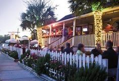 Grab a coveted seat on the Poe's Tavern porch or patio for some of the best burgers and salads around.