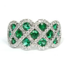 This dazzling 14K white gold ring houses thirteen round-cut emeralds, accented by an intricate basket weave design of genuine round diamonds. #hudsonpoolejewelers #emerald http://www.hudsonpoole.com/14k-white-gold-emerald-and-diamond-ring-2564.html
