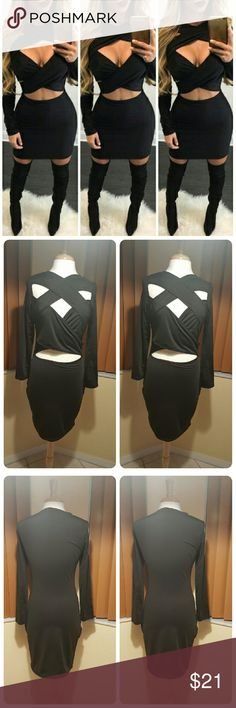JUST IN. KARLA  CRISS-CROSS BODYCON MINI DRESS 100% BNWOT. Good condition. Small snag on bottom sleeve shown in last photo. 65%cotton and 35%polyester. Solid black.long sleeves. Criss-cross opening in front,bust, and stomach area. Tight fitted. Little stretch. Bust 36 1/2 inches. Waist 28 inches.hips  34inches. Sleeves 22inches.length 37inches. This is an Asian item which tends to run small xlarge / us size 8-10. Order one size up .please measure yourself carefully before buying this item…
