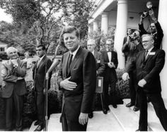 President John F. Kennedy laughs with reporters after a White House press conference May 9, 1963.