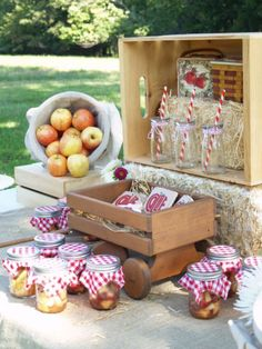 Love the tilted basket of apples for display, and also the jars with the fabric on top!