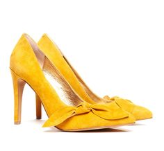 Sassy yellow suede bow heels.