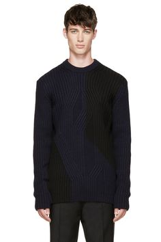 Long sleeve irregular cable knit sweater in black and dark navy blue. Ribbed crewneck collar. Fitted throughout. Tonal stitching.