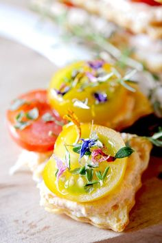 Tomato Mille Feuilles decorated with dried flowers, a little thyme and a drizzle of olive oil