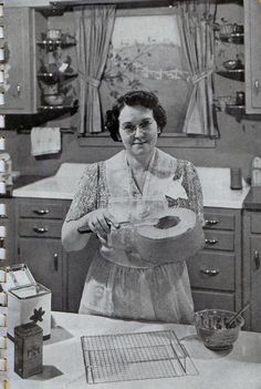 brushing off the crumbs before 'icing' corner shelves, curtains, sink lady's style was my mom's Vintage Pictures, Old Pictures, Old Photos, Vintage Baking, Vintage Kitchen, 1930s Kitchen, Vintage Advertisements, Vintage Ads, Vintage Apron