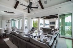 The Contemporary Jewel - Weber Design Group.  Seamless indoor-outdoor transition to covered lanai with fireplace.