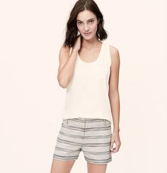 Soft ribbed trim mixes with a silky drape for a mix of sport and sweet. Scoop neck. Sleeveless. Patch chest pocket. Ribbed trim at neckline and armholes. Shirttail hem.