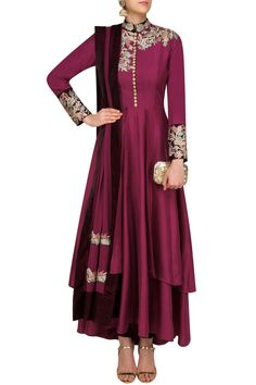 Manish Malhotra  purple anarkali in dupion crepe fabric with multi colour resham embroidered neckline and cuffs with pintucks detailing on bodice. It comes along with purple churidaar in spunsilk fabric with velvet border and purple dupatta in georgette with multi colour resham borders.