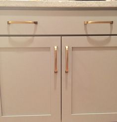 Lovely Champagne Bronze Hardware | Dove Gray Island | Wellborn Cabinets