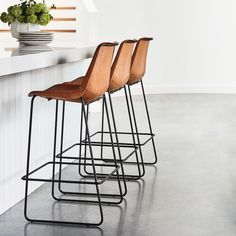 Feature handsome seating in a contemporary eat-in kitchen with the svelte Drexel Barstool, upholstered in South American leather #CocoRepublic #kitchen #kitchendecor #interiors #family