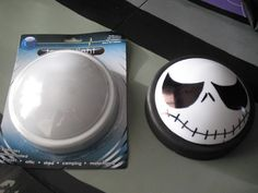 Halloween Dollar Store Project.....Touch Light with base painted black and black marker used to add face. Cheaply ingenious! Love it. Could be used as a jack o lantern too.