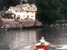 Ferryside, the former home of author Daphne du Maurier. She is in the rowboat, going towards the house.
