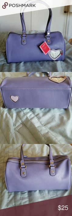 "Liz Claiborne Picture This Lavender Handbag Beautiful lavender bag with, heart photo screen, heart detail on bottom of bag, silver hardware, zipper closure, 3 inside sections(one is zipper closure), intimates zipper pocket, 6 card holder, 2 pockets for lipstick etc..., and in excellent condition!! 13""wX 6.5""h, base measures 13""X4.5"". Approximately 8"" drop, 20"" straps. Liz Claiborne Bags"