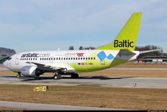 Air Baltic Boeing 737-522 YL-BBN aircraft, with the inscription ''Official carirer of LATVIA TEAM 2014'' ai the airframe, skating at Austria Salzburg W. A. Mozart International Airport. 08/02/2014.